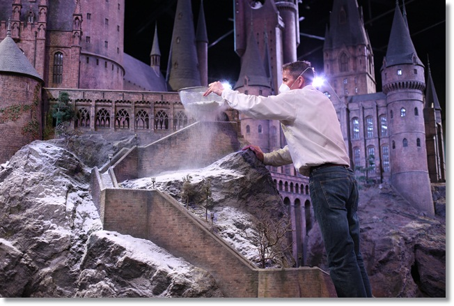 Hogwarts at Christmas: Model Effects Supervisor Jose Granell sprinkling snow on the Hogwarts model.