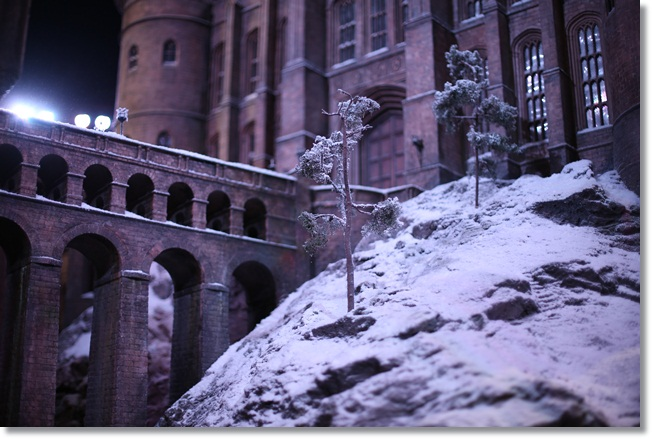 Hogwarts at Christmas: Trees are covered with snow on the Hogwarts model