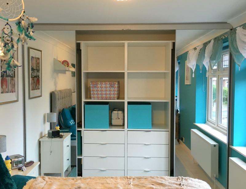 Clever storage behind sliding doors makes a teen room easier to keep organised