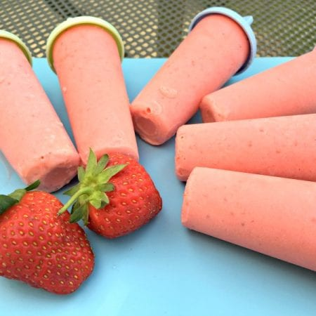 These strawberry colada ice lollies are creamy and cool - just add rum for the adults