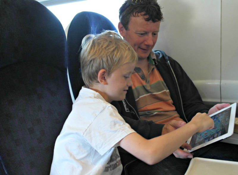 Playing iPad Monopoly on the train on a family day out