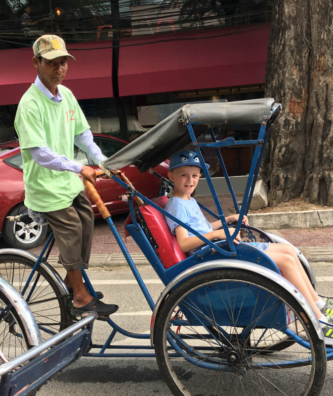 Cambodia family holiday highlights - a cyclo tour in Phnom Penh was the perfect way to get to the central market.