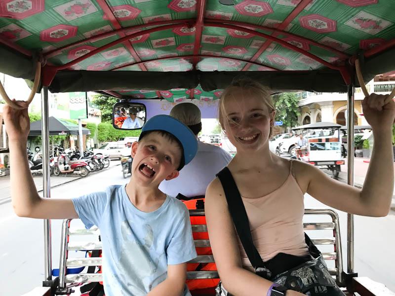 Riding a tuk tuk in Phnom Penh Cambodia with family