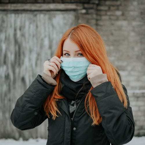 Girl wearing a surgical mask