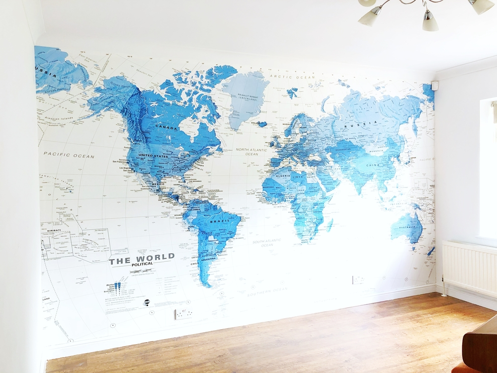 World map wallpaper mural for a teenage lounge room