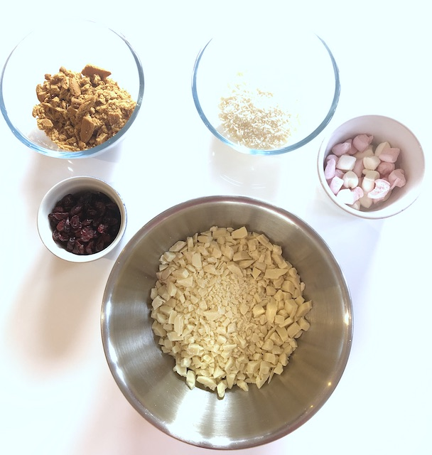 Varying the ingredients for a rocky road. White chocolate and cranberry version
