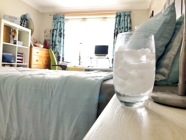 Putting iced water by your bed helps to cool the air close to your head and help you sleep in the heat